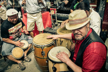 Musicians play drums during the 2012 Loisaida Festival. This year's festival will take place May 23-25, 2014.