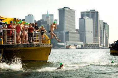 NYC Swim participants jump into the Hudson River.