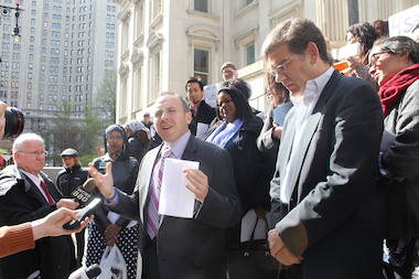 Councilman Mark Treyger (center) joined parents from across the city to protest a law they say forces the city to find space for charter schools.