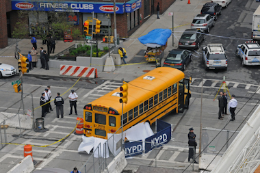 The woman was struck and killed by a school bus at East 93rd Street and Second Avenue, FDNY says.