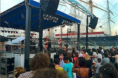 A band performs at the 2013 Seaport Music Festival.