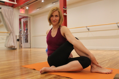 Lisa Kirchner shows off a spinal twist, which is meant to inspire forgiveness.