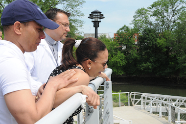 Eva Villa and Robinson Villa (left) look over the water where their son, Erickson Villa, drowned.