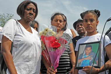 The families of 13-year-old cousins Erikson Villa and Wellington Gavin called for a fence to be put along the water at Starlight Park during a press conference their Monday after the boys drowned while swimming in the Bronx River, June 24, 2014.