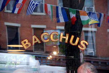 "A string of flags hangs outside Bacchus at 409 Atlantic Ave., one of 11 bars and restaurants along Atlantic Avenue hosting World Cup viewing parties for ""Summer Celebration"" on June 21. The pub crawl will begin around noon and continue until 10 p.m."