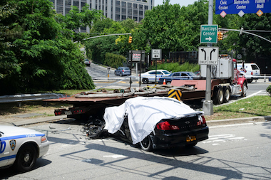 A man in a black sedan fleeing police was killed when his car smasphed into the back of a flatbed truck stopped at a