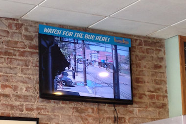 "The ""bus cam"" at Surfside Bagels helps commuters who were missing the bus getting bagels."