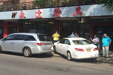 Two pedestrians were hospitalized when a white Lexus mounted the curb Tuesday afternoon, according to the FDNY.