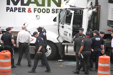 A truck driver was killed after a manhole cover crashed through his windshield, police said.