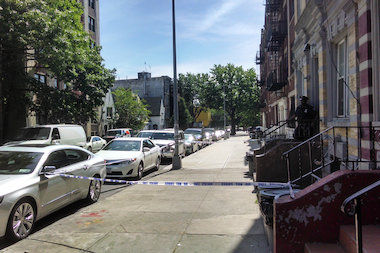 A man was shot to death inside a Prospect Place apartment building, police said.