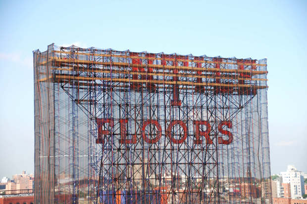 Part of the Kentile Floors sign in Gowanus was removed as of Thursday evening.