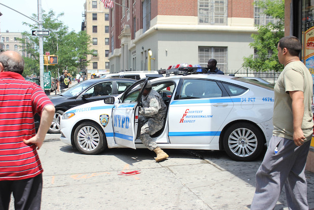 The car sent pedestrians scattering as it rolled across Wadsworth Avenue Tuesday afternoon.