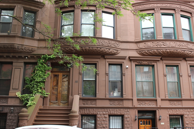 A row of brownstones across from Marcus Garvey Park in Harlem's Mount Morris Park neighborhood.