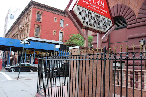 Atlah Worldwide Church accussed of making alterations to historic disitrict building without permission, including a sign used to post anti-gay messages. Protesters want the Landmarks Commission to force them to remove the sign.