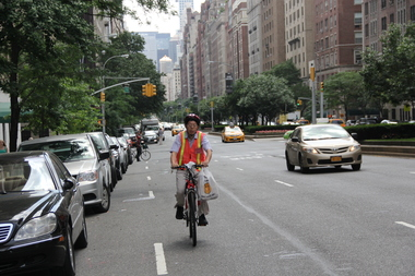 A delivery worker scales Park Avenue.