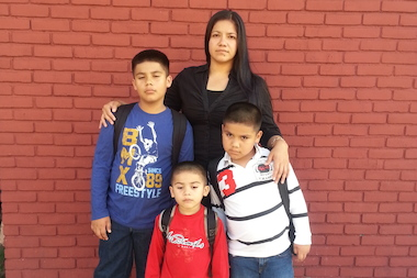 Sunset Park mom Jovita Sosa, with her sons James (who will be entering fifth grade in September), Justin (who will be in kindergarten) and Jason (who is going into pre-K). All three were placed in different schools.