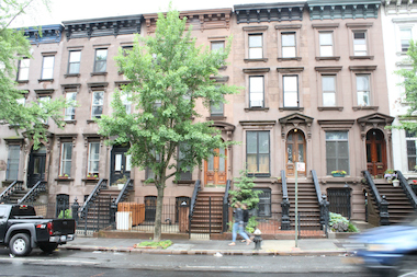 Public Advocate Letitia James's three-story rental property (centered, behind tree) has not been registered with the city's Department of Housing Preservation and Development since 2007 — a violation of city law that could bring a fine of $500. The property has 12 open HPD violations, three of which occurred since she became the owner.