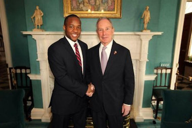 Milan Taylor, seen with Mayor Michael Bloomberg, allegedly choked a woman inside the offices of the Rockaway Youth Task Force.