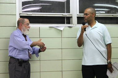 Rabbi Jacob Goldstein, left, served as the chairman of Community Board 9 in Brooklyn for 34 years. Dwayne Nicholson, right, was chosen to take over that role in an election held by the board Tuesday night.
