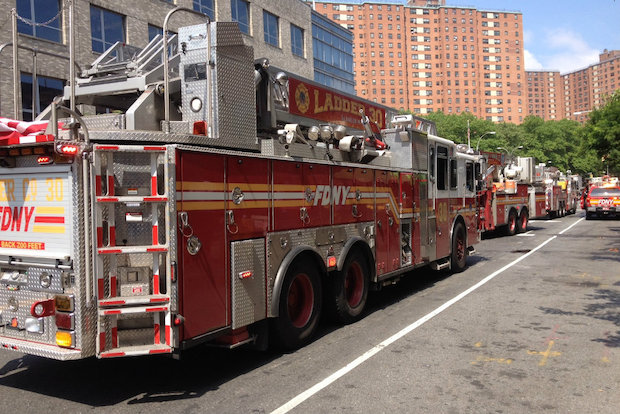 Flames erupted inside a West 125th Street USPS building, the FDNY said.