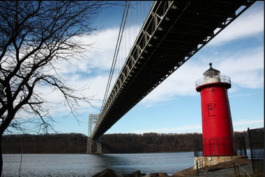 The Little Red Lighthouse is located under the George Washington Bridge on the Hudson River Greenway.