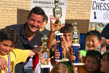 Chess coach Russ Makofsky with P.S. 33 students, who recently took ninth place in the United States Chess Federation's Elementary Nationals K-3 Tournament in Dallas.