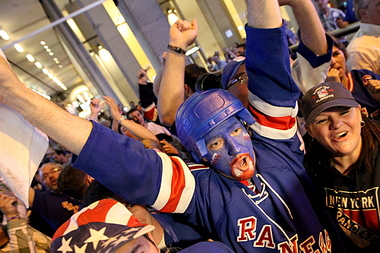 Fans celebrate a Rangers victory in 2012.