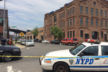 Police taped off a section of 13th Street, where a gunman barricaded himself within a building, according to the NYPD.