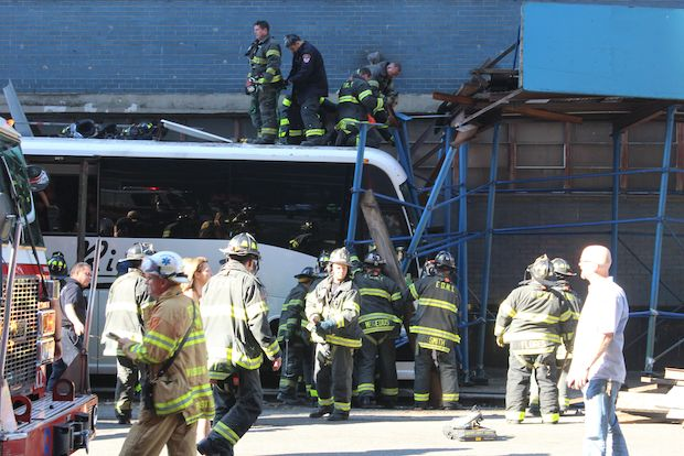 The bus crashed into scaffolding at 10th Avenue and 41st Street, the FDNY said.