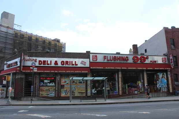 This one-story commercial property on Flushing was demolished in favor of an apartment building development.