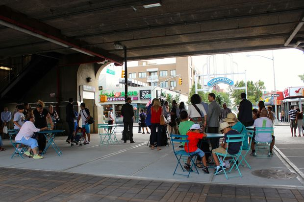 The area under the 46th St. station is now Bliss Plaza, a sitting area with tables, chairs and planters.