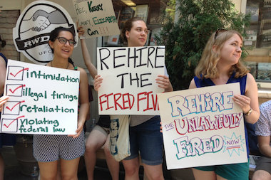 Mary Heatwole (right) and Devon Dunn (center) prostest with other Book Culture employees at 112th Street and Broadway on Wednesday July 2, 2014.