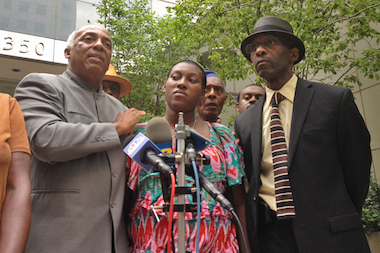 Charles Barron and Rosan Miller hold a press conference after meeting with Brooklyn District Attorney Kenneth Thompson at his office after a video surfaced showing an officer briefly use a chokehold on the pregnant Miller during a barbecue in East New York, July 29, 2014.