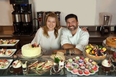 Selvaggia Pizzetti and chef Alejandro Quinones with a wide selection of treats at Crave.it