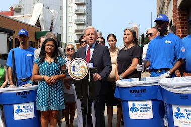 City Councilman Jimmy Van Bramer and workers from The Doe Fund at an announcement earlier this summer. Workers from the nonprofit will now clean 36th Avenue in Dutch Kills.