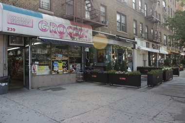 Dyckman Seaman Grocery closed in July 2014. Mama Sushi, seen here next door, has since expanded into the space.