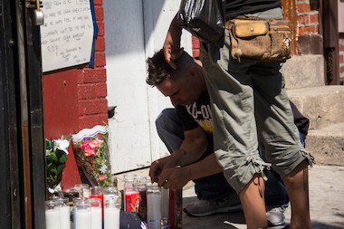 Mourners set up a makeshift memorial where Eric Garner died while police were arresting him.
