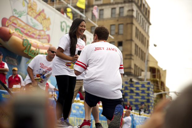 Reigning Nathan's hot dog eating champion Joey Chestnut held onto his title after downing 61 hot dogs in 10 minutes — and after proposing to his girlfriend. Women's champ and newcomer, Miki Sudo, who weighs a mere 120 pounds, won after eating 34 hot dogs in 10 minutes.