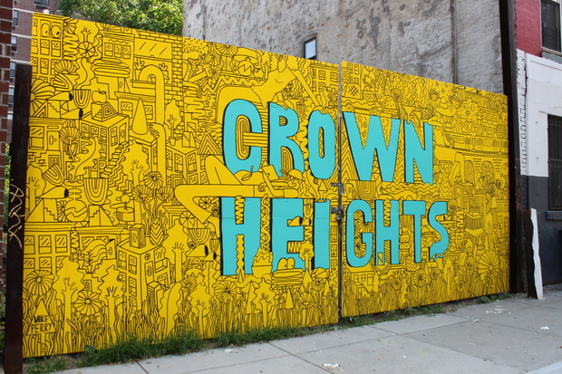 Local artist Mike Perry painted a new neighborhood mural on the doors to an empty lot on Bergen Street in Crown Heights.