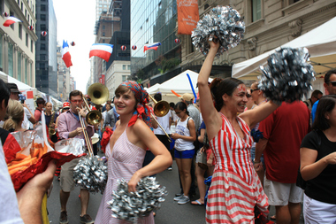 The Hungry March Band parading on 60th Street for Bastille Day on 60th Street festival. For over ten years, the street fair has been celebrating France national day by bringing French delicacies as well as live-performances to 60th Street, between Fifth and Lexington avenues. Bastille Day commemorates the storming of a French prison, the Bastille, on July 14, 1789. The event marked the beginning of the French Revolution which led to the overthrown of France's monarchy.