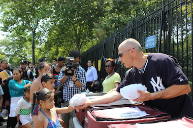 New York Yankees manager Joe Girardi was at Thomas Jefferson Pool in East Harlem Wednesday with City Council Speaker Melissa Mark-Viverito to push what is the largest summer feeding program in the country.