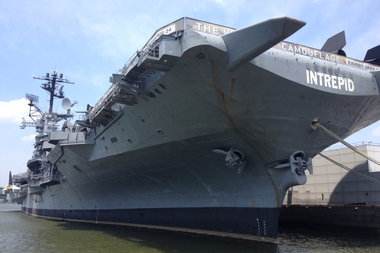Workers doing repairs to a power supply at the Intrepid received burns, officials said.