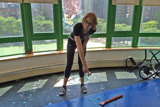 A piece of metal shattered a window and injured a woman at Asphalt Green on the Upper East Side July 9, 2014, according to the FDNY and advocacy group Pledge 2 Protect.