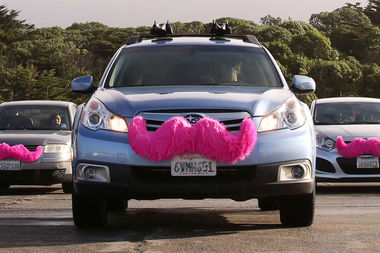 Lyft cars, with their signature pink moustaches. The company has begun outreach to drum up support in New York City.