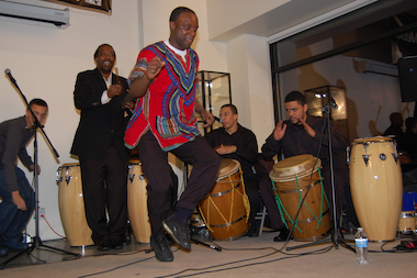 Garifuna Chester Nuñez dances to Matthew Gonzalez and Jorge Vazquez playing Puerto Rican bomba drums at last year's Parranda con Paranda event.