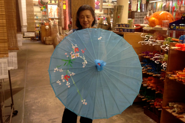"""After so many years, it's become a fashion item, said Shing Yeh Chen, president of SoHo's Pearl River Market, which carries a diverse collection of paper, nylon and silk parasols."