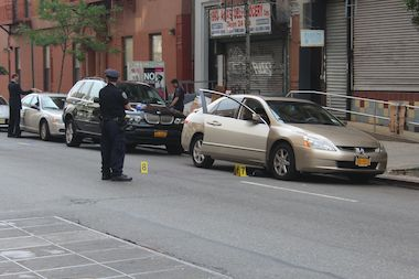 A man was killed and two others injured when a shooter opened fire on them in East Harlem Tuesday morning, police said.