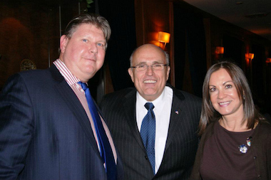 Terrence Tierney (left) poses with former Mayor Rudy Giuliani and his wife, Judith, at a fund-raiser for Tierney's charity, Friends of the Fighting 69th. The state Attorney General's Office is currently investigating Tierney after complaints that he allegedly misused the charity's funds, court records show.