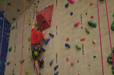 Adam Payne has a neuromuscular condition that requires him to use leg braces or a wheelchair. In spite of that, he is pursuing competitve rock climbing.