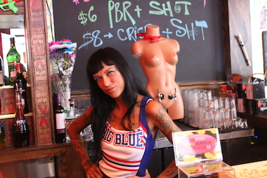 "Boobie Trap, 308 Bleecker St., opened in Bushwick in August. It's an eclectic ""bartender's bar"" filled with items that take its name literally — ""color my boobs"" coloring sheets, nude magazine centerfolds, boobs inside glass ornaments on the wall and a shirtless female mannequin with the bar's only two beer taps attached to it."